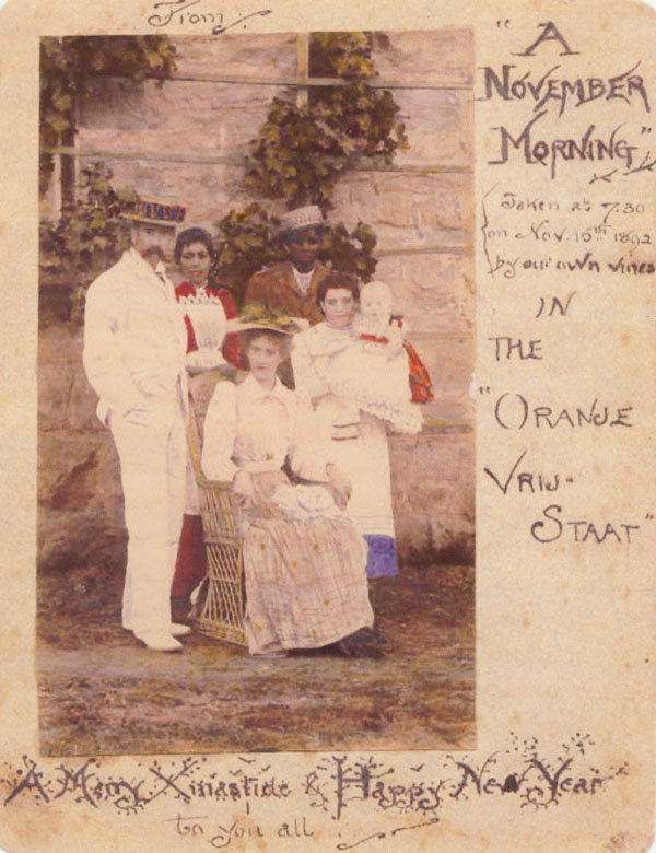 Handwritten Christmas card with a colored photo of the Tolkien family, sent by Mabel Tolkien from the Orange Free State to her relatives in Birmingham, on November 15, 1892.
